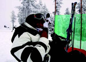 A participant of SOS Outreach's SnowCore program enjoys a day skiing at Snoqualmie Summit in Snoqualmie, Washington. SnowCore is an exposure program that provides underserved youth with one- or two-day ski or snowboard trips.